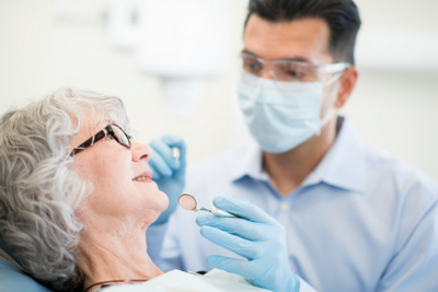 woman being treated by dentist